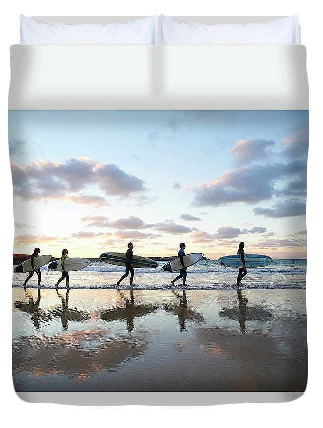 Young Men Duvet Cover featuring the photograph Five Surfers Walk Along Beach With Surf by Dougal Waters