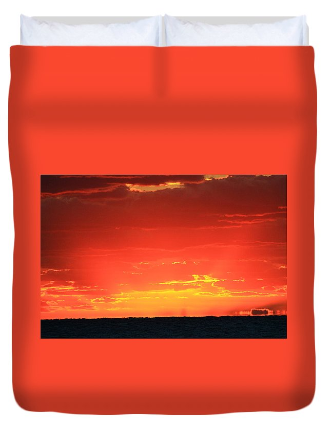 Jupiter Duvet Cover featuring the photograph Flaming Ocean by Catie Canetti