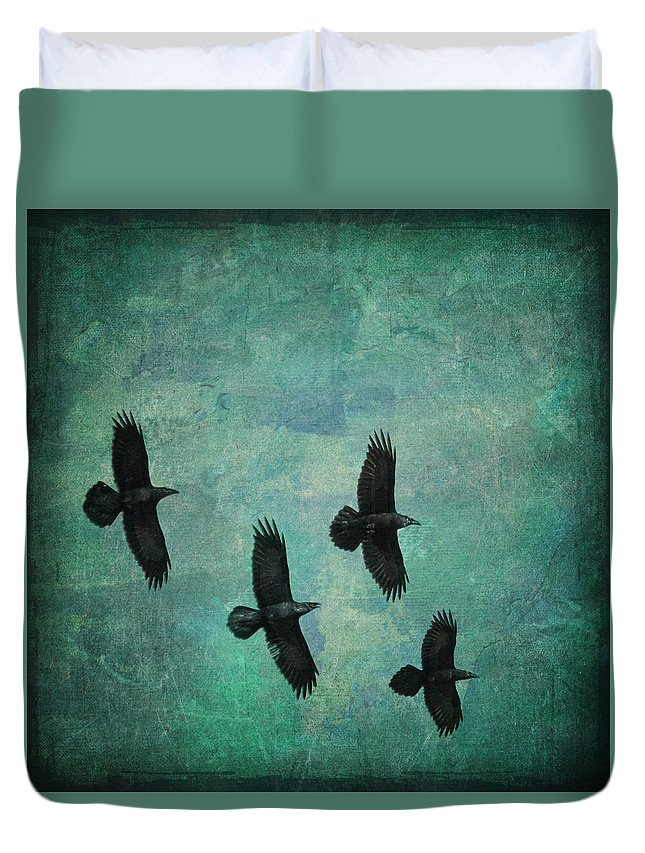 Ravens Duvet Cover featuring the photograph Flying Ravens by Peggy Collins