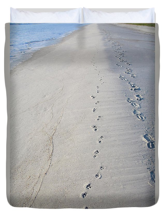 Footprint Duvet Cover featuring the photograph Footprints And Pawprints by Diane Macdonald