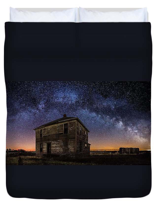 Milky Way Duvet Cover featuring the photograph Forgotten Under The Stars by Aaron J Groen
