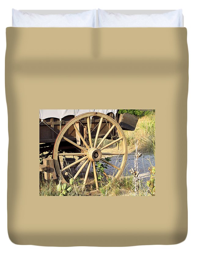 Pioneer Duvet Cover featuring the photograph Fort Laramie Wy - Moving West On Wagon Wheels by Christine Till