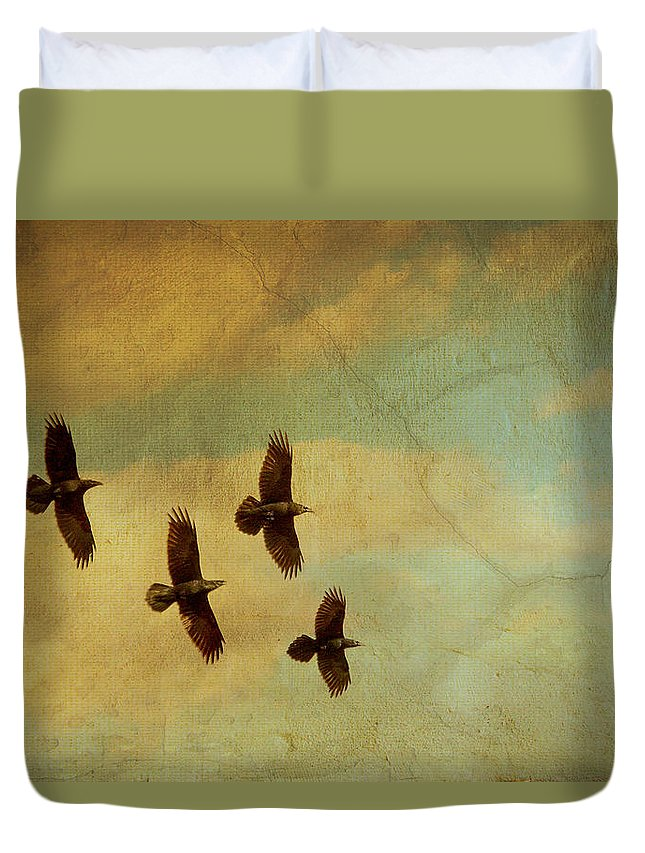 Ravens Duvet Cover featuring the photograph Four Ravens Flying by Peggy Collins