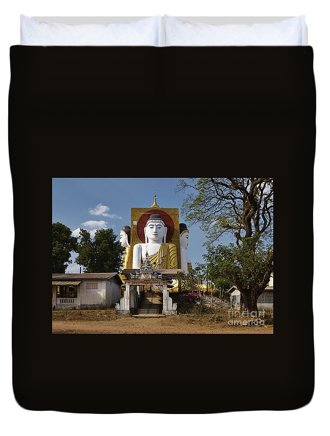 Myanmar Duvet Cover featuring the photograph four sitting Buddhas 30 metres high looking in four points of the compass at Kyaikpun Pagoda by Juergen Ritterbach