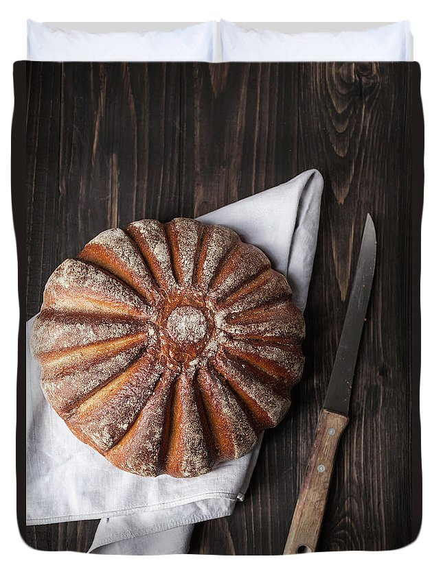 Kitchen Knife Duvet Cover featuring the photograph Fresh Baked Bread With Kitchen Knife On by Westend61