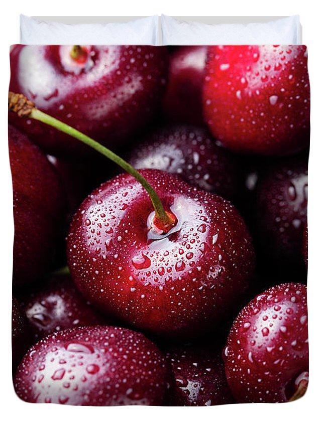 Cherry Duvet Cover featuring the photograph Fresh Ripe Black Cherries Background by Anna Pustynnikova