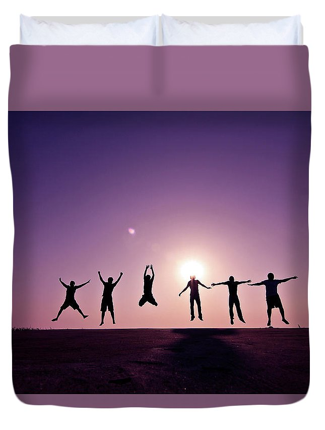 Human Arm Duvet Cover featuring the photograph Friends Jumping Against Sunset by Kazi Sudipto Photography