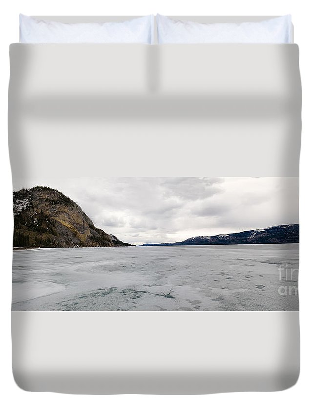 Adventure Duvet Cover featuring the photograph Frozen Lake Laberge Yukon Canada by Stephan Pietzko