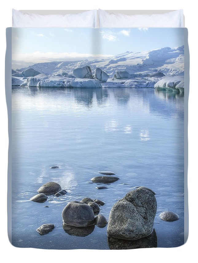 Jokulsarlon Duvet Cover featuring the photograph Frozen Serenity by Evelina Kremsdorf