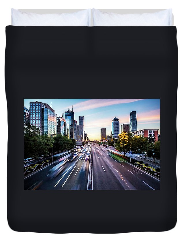 Scenics Duvet Cover featuring the photograph Futuristic City At Dusk by Itsskin
