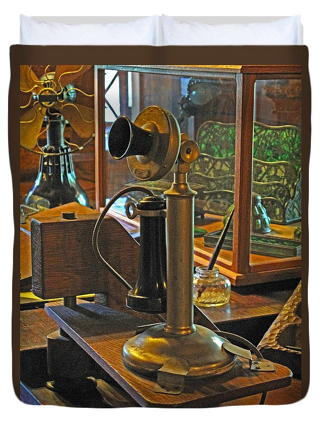 Antiques Duvet Cover featuring the photograph Gillette's Phone And Fan by Barbara McDevitt