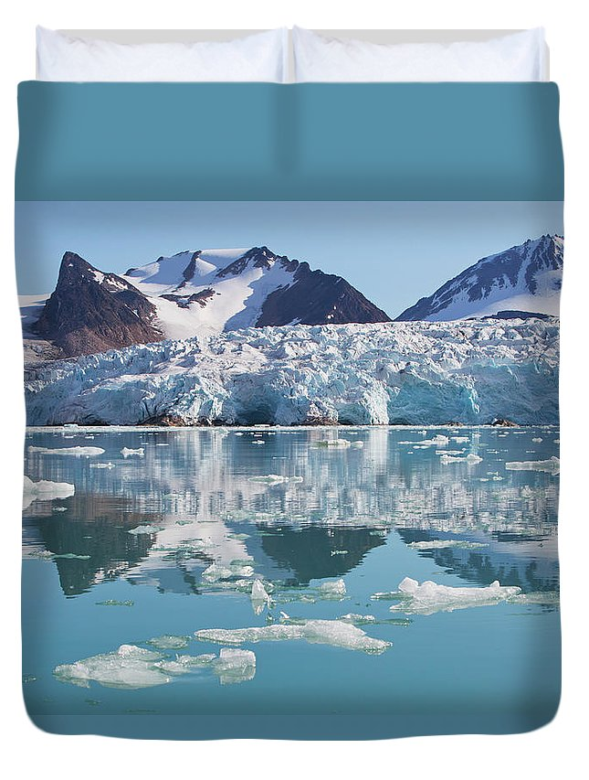 Scenics Duvet Cover featuring the photograph Glaciers Tumble Into The Sea In The by Anna Henly