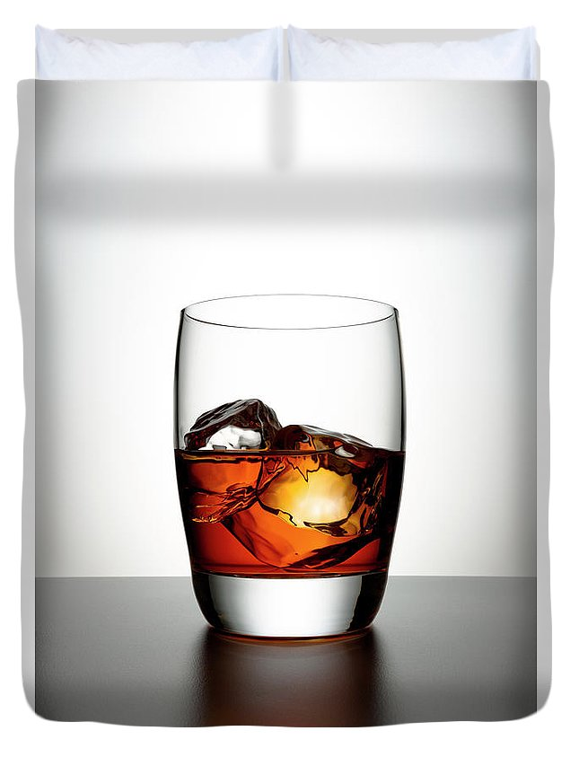 White Background Duvet Cover featuring the photograph Glass With Brown Liquor And Ice Cubes by Chris Stein