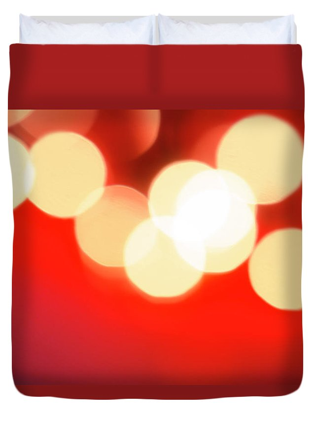 Christmas Lights Duvet Cover featuring the photograph Glowing Light On Red Background, Studio by Tetra Images