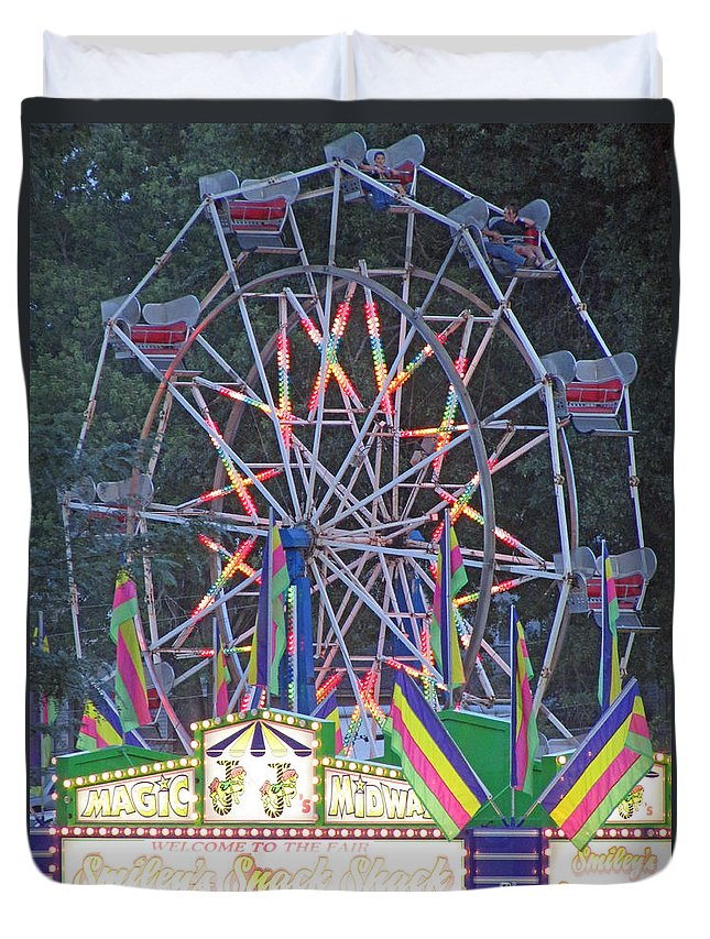 Rides Duvet Cover featuring the photograph Going Around by Jamie Smith