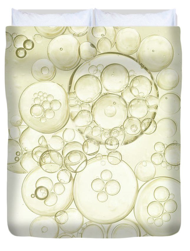 Purity Duvet Cover featuring the photograph Gold Bubbles Of Oil And Water by Level1studio