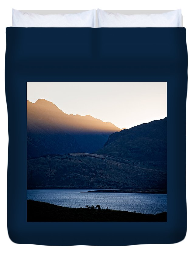 New Zealand Duvet Cover featuring the photograph Golden Rays by Dave Bowman