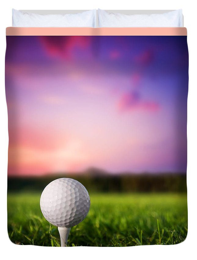 Ball Duvet Cover featuring the photograph Golf ball on tee at sunset by Michal Bednarek