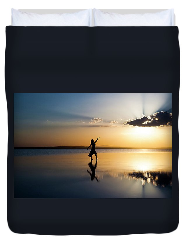 Ballet Dancer Duvet Cover featuring the photograph Grace At Sunset by Guvendemir