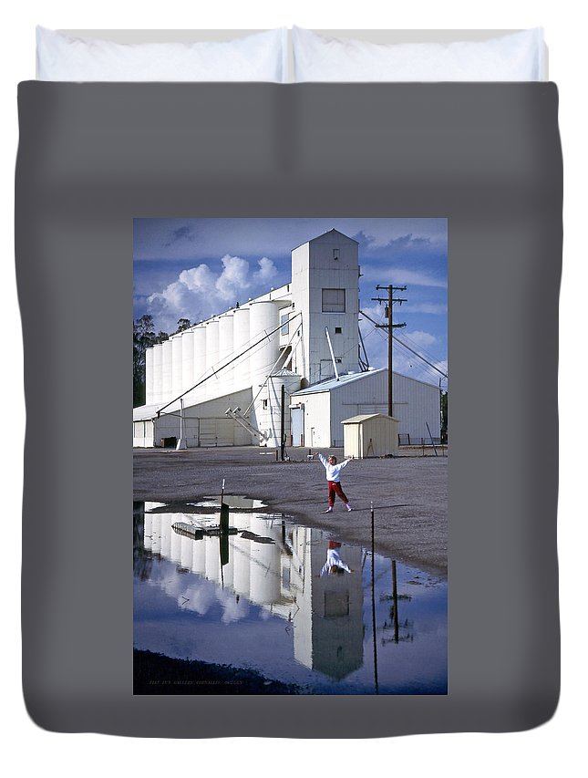 Grain Elevators Duvet Cover featuring the photograph Grain Elevators And Child by Michael Moore