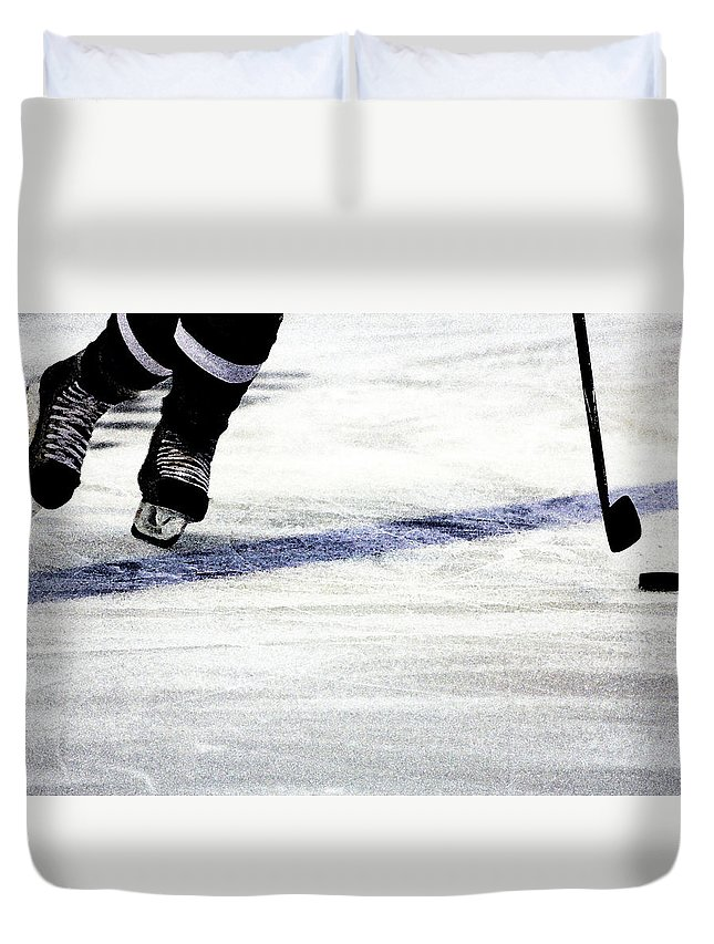 Hockey Duvet Cover featuring the photograph He Skates by Karol Livote