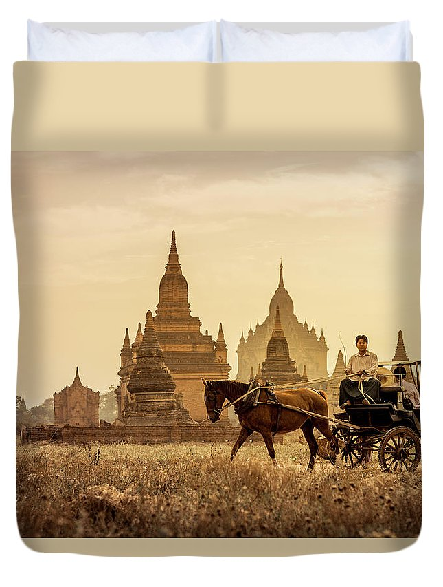 Horse Duvet Cover featuring the photograph Horse And Carriage Turning By Temples by Merten Snijders