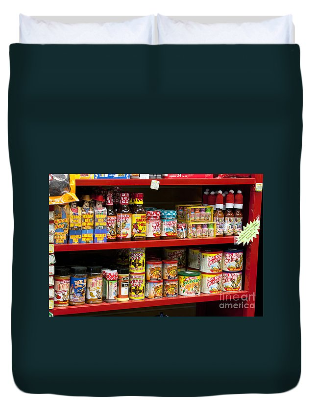 Assortment Duvet Cover featuring the photograph Hot Sauce On Store Shelf by Gunter Nezhoda