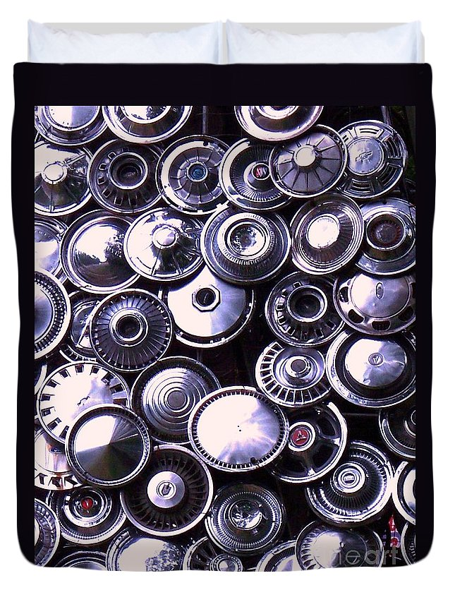 Hubcaps Duvet Cover featuring the photograph Hubcaps by Eric Schiabor