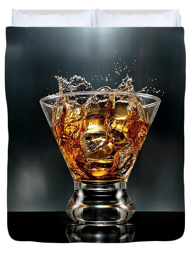 Alcohol Duvet Cover featuring the photograph Ice Cube Splash Alcohol Drink by Chris Stein