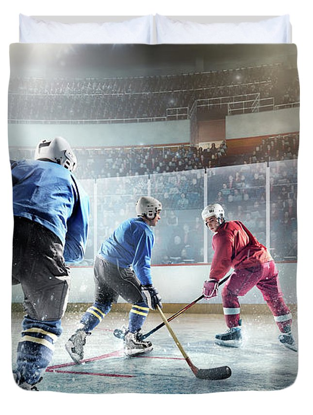 Sports Helmet Duvet Cover featuring the photograph Ice Hockey Players In Action by Dmytro Aksonov