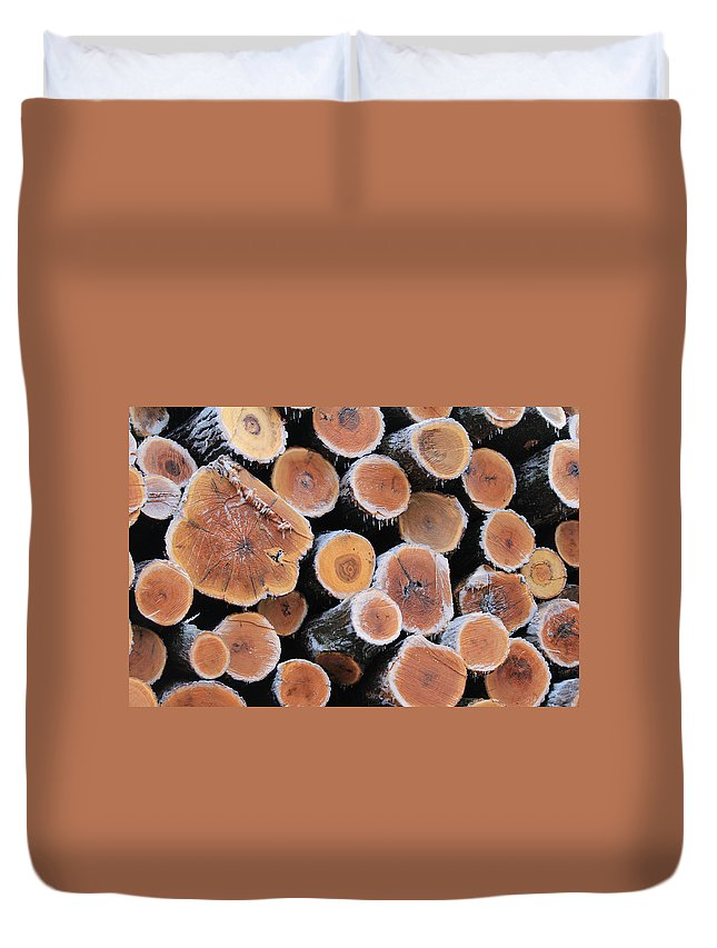 Lumber Duvet Cover featuring the photograph Ice Logs by Carrie Godwin