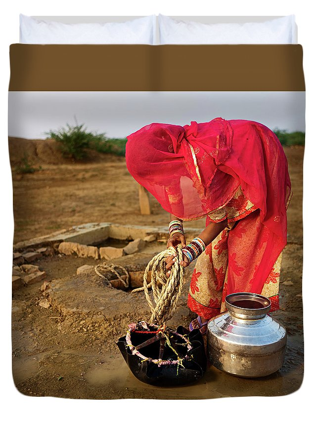 Working Duvet Cover featuring the photograph Indian Woman Getting Water From The by Hadynyah