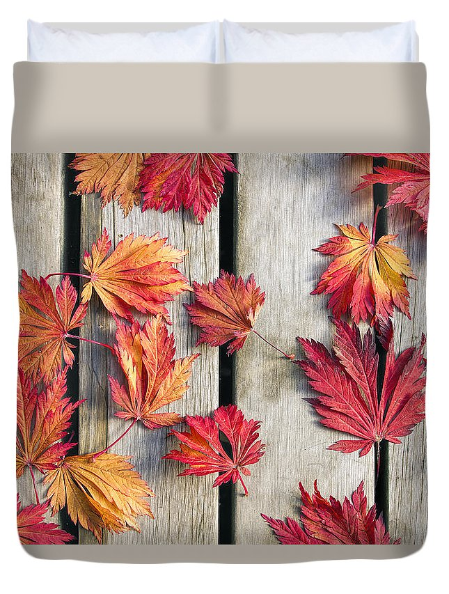 Japanese Duvet Cover featuring the photograph Japanese Maple Tree Leaves on Wood Deck by David Gn