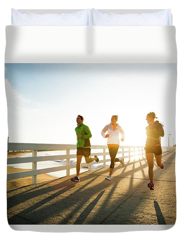 Young Men Duvet Cover featuring the photograph Jogging Along The Coast by Jordan Siemens