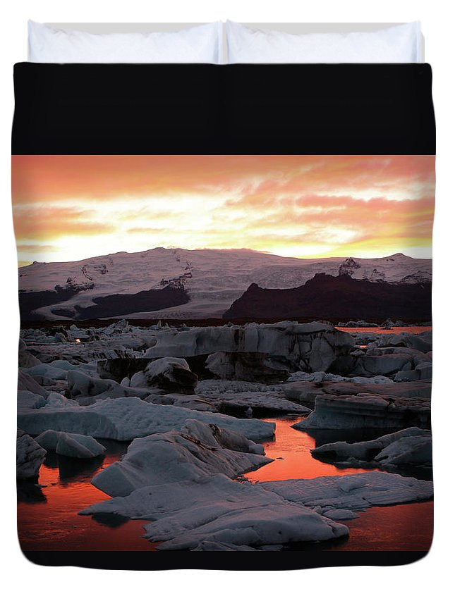 Scenics Duvet Cover featuring the photograph Jokulsarlon Lagoon At Sunset by Richard Collins