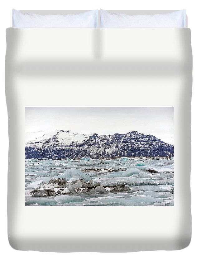 Tranquility Duvet Cover featuring the photograph Jokulsarlon by Photo By Dave Moore