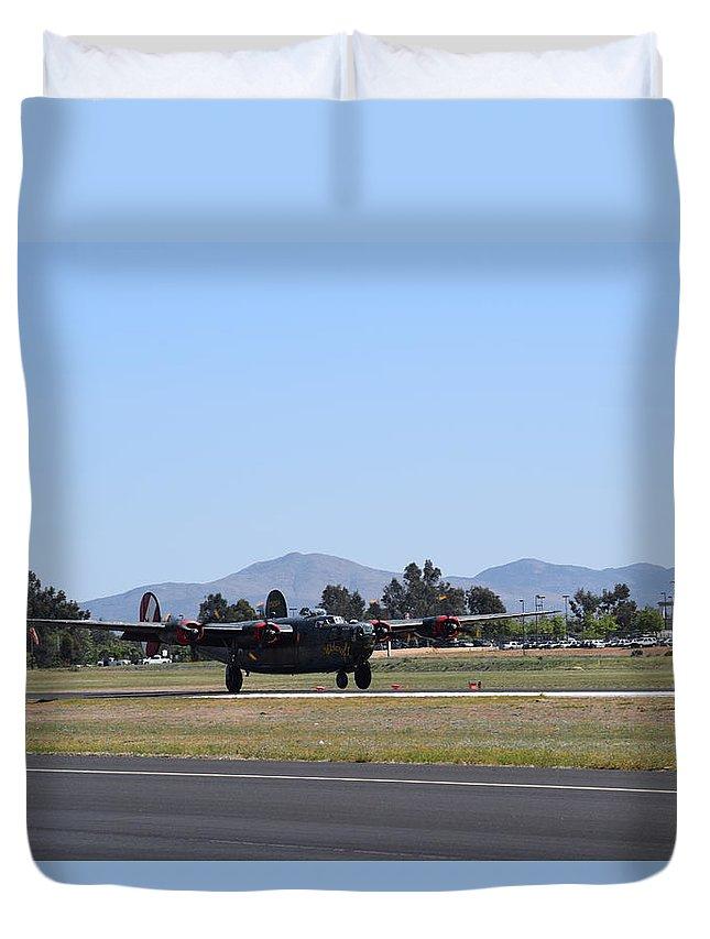 B-24 Duvet Cover featuring the photograph Liberator Returns To Earth by Steve Scheunemann