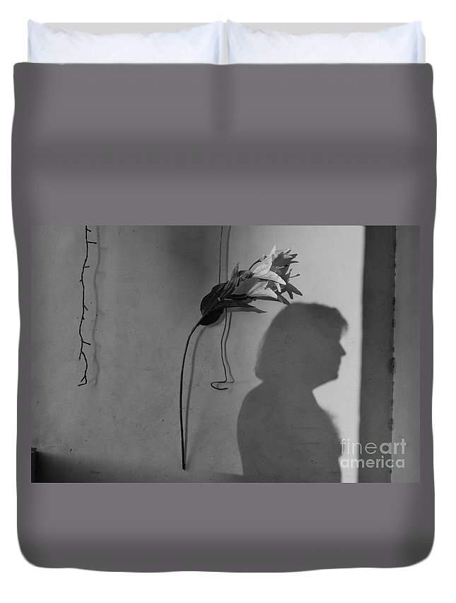 Male Duvet Cover featuring the photograph Lily And Male Figure Shadow by Christopher Shellhammer
