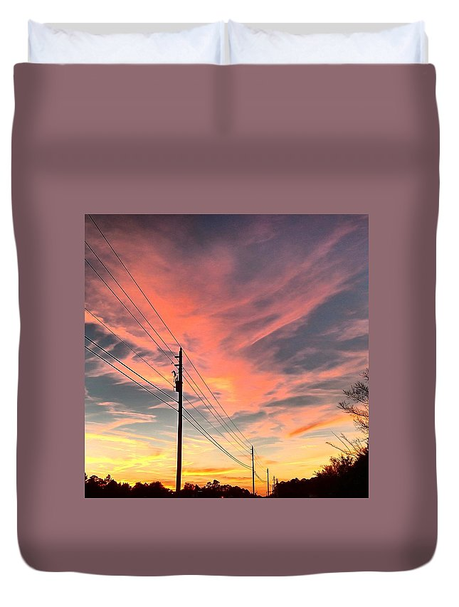 Sunset Duvet Cover featuring the photograph Lined Up by Tyson Kinnison