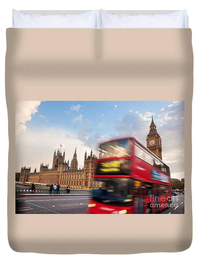 London Duvet Cover featuring the photograph London The Uk Red Bus In Motion And Big Ben by Michal Bednarek