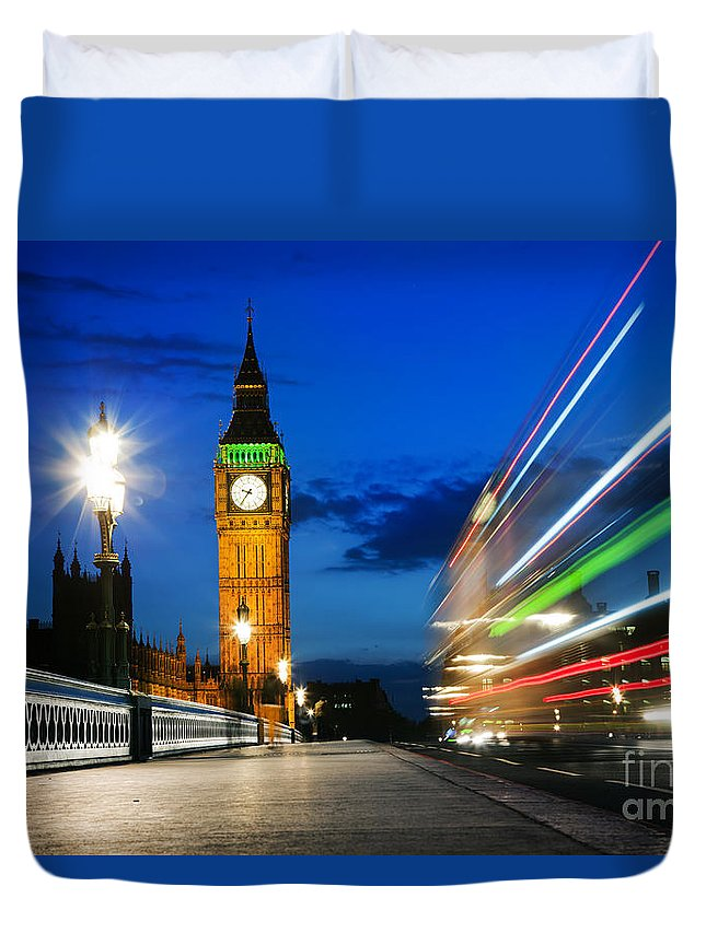 London Duvet Cover featuring the photograph London Uk Red Bus In Motion And Big Ben At Night by Michal Bednarek