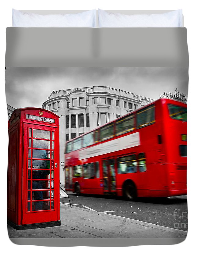 London Duvet Cover featuring the photograph London Uk Red Phone Booth And Red Bus In Motion by Michal Bednarek