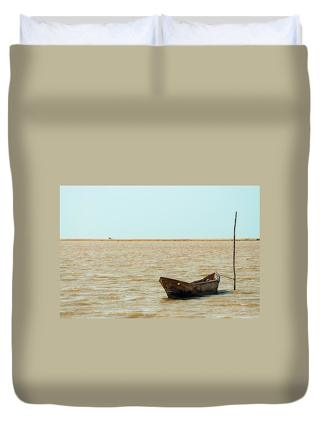 Water Duvet Cover featuring the photograph Lone Canoe by Jess Kraft