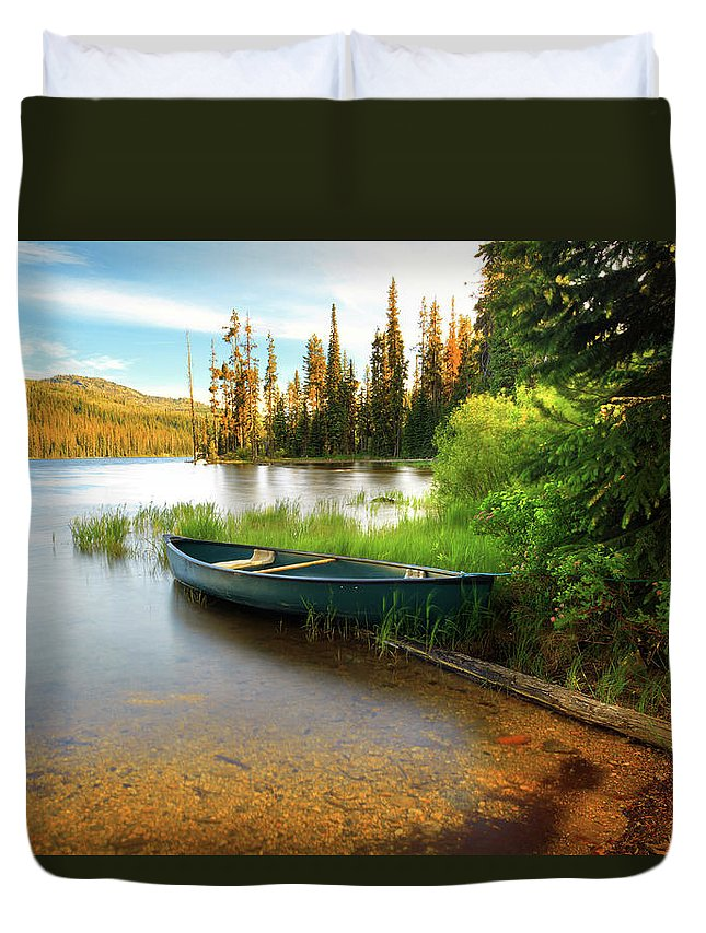 Tranquility Duvet Cover featuring the photograph Lone Canoe On Shores Of Upper Payette by Anna Gorin