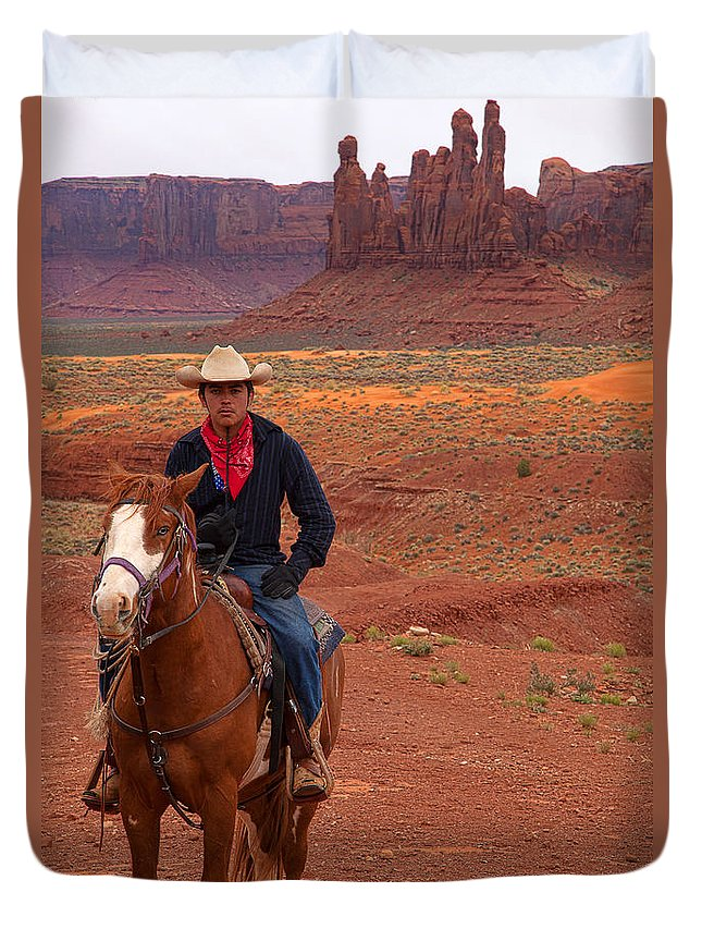 Red Soil Duvet Cover featuring the photograph Lone Rider by Jim Garrison