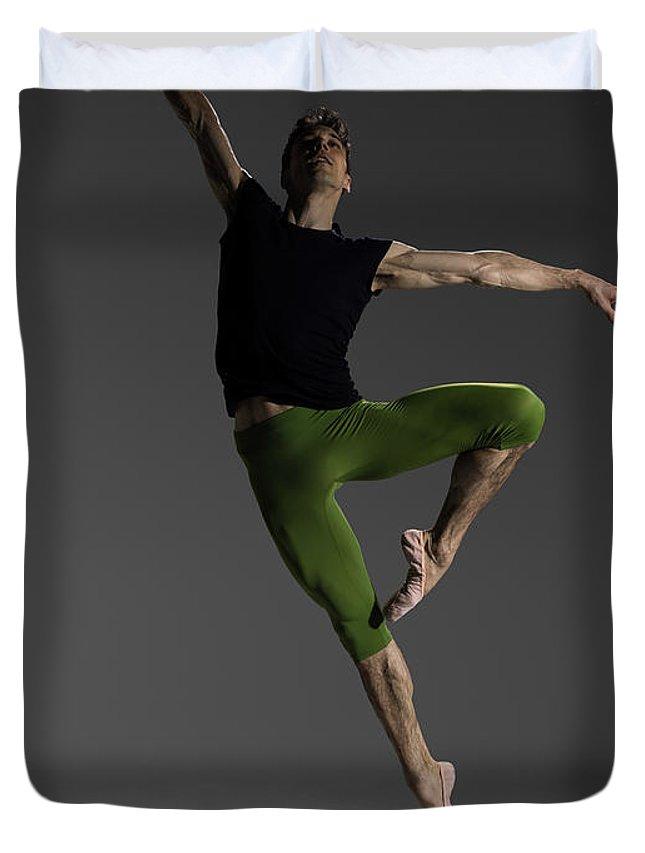 Ballet Dancer Duvet Cover featuring the photograph Male Ballet Dancer Jumping In Passé by Nisian Hughes
