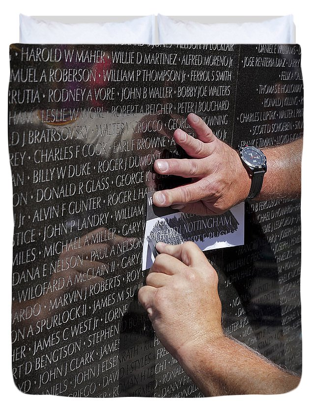 Memorial Duvet Cover featuring the photograph Man Getting A Rubbing Of Fallen Soldier's Name At The Vietnam War Memorial by B Christopher