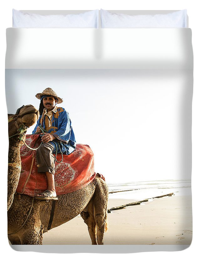 Agadir Duvet Cover featuring the photograph Man On Camel On Beach, Taghazout by Tim E White