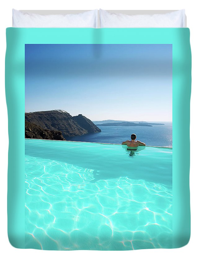 People Duvet Cover featuring the photograph Man Relaxing Looking At Santorini by Peskymonkey