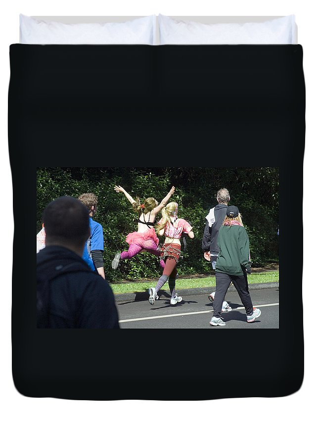 Race Duvet Cover featuring the photograph Marathon Grand Jete by Daniel Furon